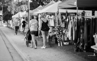Black and white photo of an outdoor artisan marketplace