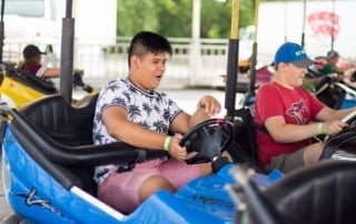 Carnival goers enjoying bumper cars carnival attraction