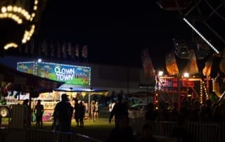 People milling about a carnival at night